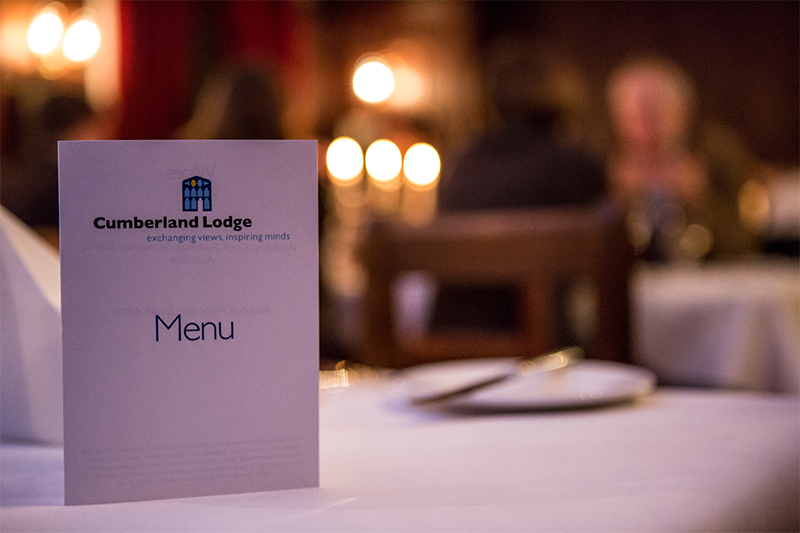 Menu on a candle-lit dining table at Cumberland Lodge
