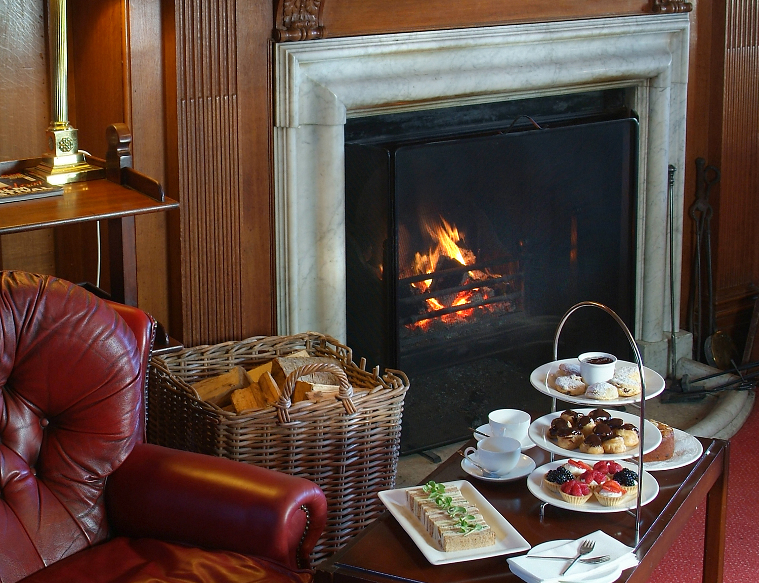 Afternoon tea by a roaring fire, Cumberland Lodge