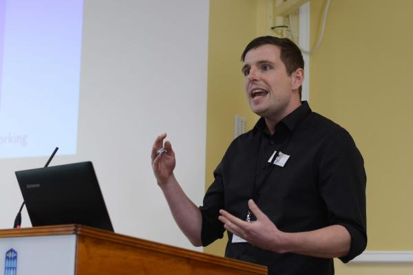 Alex Blower, Cumberland Lodge Scholar, speaking at a conference at Cumberland Lodge