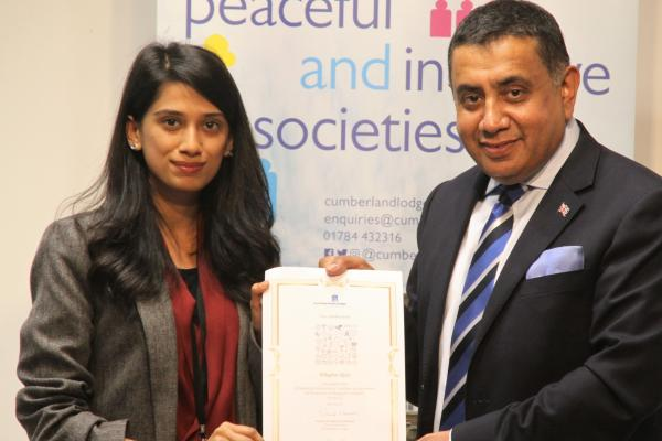 International student graduating from the Cumbelrnad Lodge Emerging International Leaders programme, with Lord Ahmad of Wimbledon