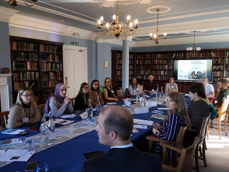 Students taking part in St Catharine's Session discussions in the Library at Cumberland Lodge