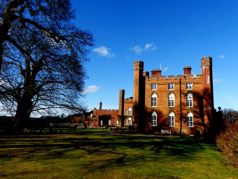 Side view of Cumberland Lodge in winter, from the grounds